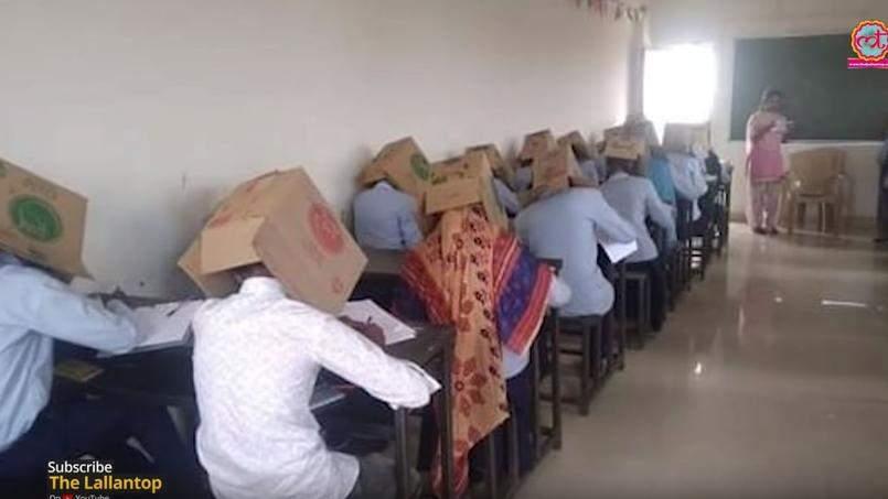 Inde : Chaque élève met un carton sur la tête pour éviter la tricherie