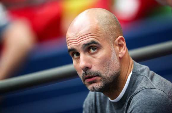 Manchester City : Malgré la sanction Pep Guardiola veut rester au club