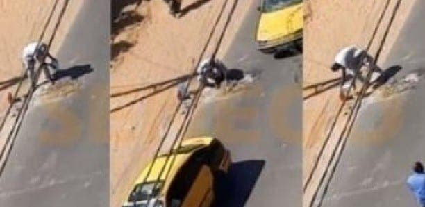 Sénégal : Un chauffeur de taxi achète du ciment pour combler un trou sur la route (Vidéo)